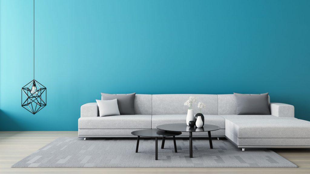 kleur kiezen woonkamer - blauwe muur - grijze bank